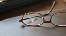 Lens of broken eyeglasses